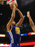 Feb. 10, 2011; Phoenix, AZ, USA; Golden State Warriors forward Brandan Wright (32) puts up a shot against the Phoenix Suns at the US Airways Center. The Suns defeated the Warriors 112 - 88. Mandatory Credit: Jennifer Stewart-US PRESSWIRE