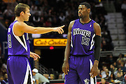 Oct. 30, 2010; Cleveland, OH, USA; Sacramento Kings point guard Beno Udrih (19) talks with point guard Tyreke Evans (13) during the third quarter at Quicken Loans Arena. The Kings beat the Cavaliers 107-104. Mandatory Credit: Jason Miller-US PRESSWIRE