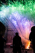 Silhouettes of people watching fireworks explode around the Parroquia San Miguel Archangel church during the Alborada festival in front of September 29, 2018 in San Miguel de Allende, Mexico. The unusual festival celebrates the cities patron saint with a two hour-long firework battle at 4am representing the struggle between Saint Michael and Lucifer.