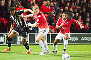 Grimsby Town forward Matt Green challenged by Salford City defender Carl Piergianni during the EFL Sky Bet League 2 match between Salford City and Grimsby Town FC at Moor Lane, Salford, United Kingdom on 17 September 2019.