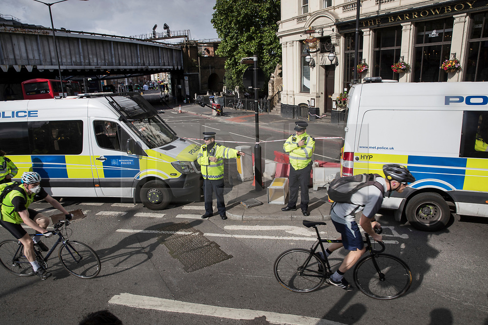 © Licensed to London News Pictures. 05/06/2017. London, UK. Police vehicles surround the spot on the southern end of London Bridge where a white van crashed following a terrorist attack in Saturday evening. Three men attacked members of the public  after a white van rammed pedestrians on London Bridge.   Ten people including the three suspected attackers were killed and 48 injured in the attack. Photo credit: Peter Macdiarmid/LNP
