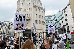 "© Licensed to London News Pictures. 02/06/2017. London, UK. Demonstrators gather outside the BBC headquarters in protest against the Corporation for not playing the song ""Liar Liar"" by Captain Ska on BBC Radio 1.  Organised by The People's Alliance, people carried signs bearing an image of Prime Minister Theresa May with the words ""Liar Liar"" and ""You Can't Trust Her"" on each side.   Photo credit : Stephen Chung/LNP"