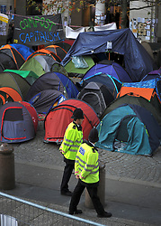 © Licensed to London News Pictures. 17/11/2011, London, UK. Policemen walk past Occupy London tents outside St Paul's Cathedral today 17 November 2011.  Photo credit : Stephen Simpson/LNP