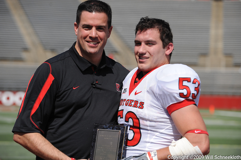 Apr 18, 2009; Piscataway, NJ, USA; Rutgers Athletic Director Tim Pernetti awards LB Jim Dumont the Frank R. Burns award for extraordinary toughness during spring practice during halftime of Rutgers' Scarlet and White spring football scrimmage.