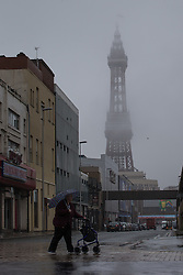 © Licensed to London News Pictures . 17/06/2015. Blackpool  , UK . The Blackpool Tower partially obscured by fog . Rain and fog over Blackpool today ( Wednesday 17th June 2015 ) . Photo credit : Joel Goodman/LNP