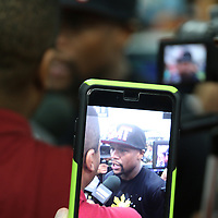 LAS VEGAS, NV - APRIL 14: WBC/WBA welterweight champion Floyd Mayweather Jr. is seen in a cellphone as he is being interviewed by members of the media before he works out at the Mayweather Boxing Club on April 14, 2015 in Las Vegas, Nevada. Mayweather will face WBO welterweight champion Manny Pacquiao in a unification bout on May 2, 2015 in Las Vegas.  (Photo by Alex Menendez/Getty Images) *** Local Caption *** Floyd Mayweather Jr.