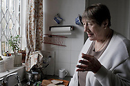 Old lady at her flat in London .Photo©Amaya Roman/Workers Photos