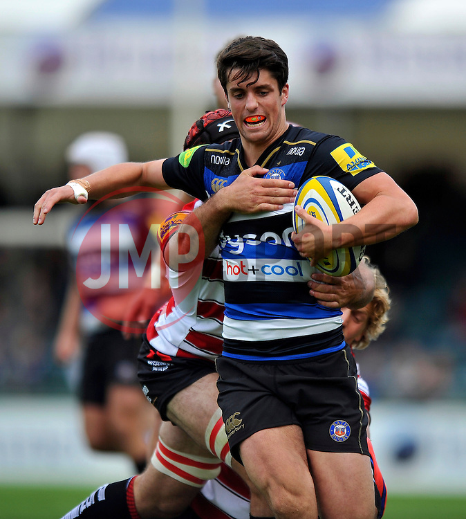 Adam Hastings of Bath Rugby takes on the Gloucester defence - Mandatory byline: Patrick Khachfe/JMP - 07966 386802 - 13/09/2015 - RUGBY UNION - Memorial Stadium - Bristol, England - Gloucester Rugby v Bath Rugby - West Country Challenge Cup.
