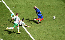 Shane Duffy of Republic of Ireland is shown a strait Red for his foul on Antoine Griezmann of France  - Mandatory by-line: Joe Meredith/JMP - 26/06/2016 - FOOTBALL - Stade de Lyon - Lyon, France - France v Republic of Ireland - UEFA European Championship Round of 16