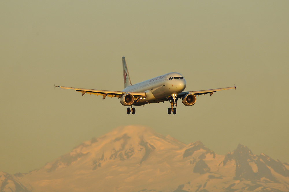 Air Canada Airbus A321 sunset landing with Mount Baker background