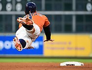 Houston Astros' George Springer advances to second after a fly out by Jose Altuve during the fourth inning of a baseball game against the Oakland Athletics, Friday, April 27, 2018, in Houston. (AP Photo/Eric Christian Smith)
