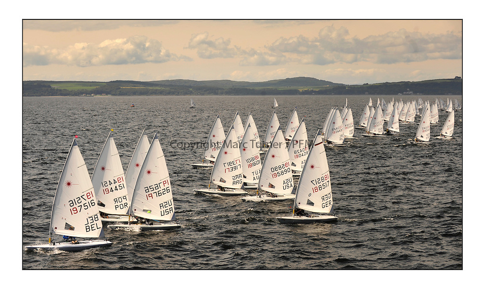 Perfect conditions at day 4 of the World Laser Radial Youth Championships, Largs, Scotland...Men's Yellow flight startline. ..317 Youth Sailors from 42 different nations compete in the World and European Laser Radial Youth Champiponship from the 17-25 July 2010...The Laser Radial World Championships take place every year. This is the first time they have been held in Scotland and are part of the initiaitve to bring key world class events to Britain in the lead up to the 2012 Olympic Games. ..The Laser is the world's most popular singlehanded sailing dinghy and is sailed and raced worldwide. ..Further media information from .laserworlds@gmail.com.event press officer mobile +44 7866 571932 and +44 1475 675129 .