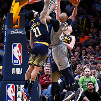 05 April 2018: Minnesota Timberwolves forward Taj Gibson (67) goes for the dunk on Denver Nuggets forward Wilson Chandler (21) and Denver Nuggets center Nikola Jokic (15) during the Denver Nuggets 100-96 victory over the Minnesota Timberwolves, at the Pepsi Center, Denver, Colorado, USA.