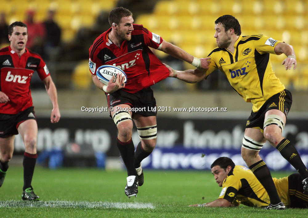 Jeremy Thrush tries to scrag Kieran Read. Super 15 rugby match - Crusaders v Hurricanes at Westpac Stadium, Wellington, New Zealand on Saturday, 18 June 2011. Photo: Dave Lintott / photosport.co.nz