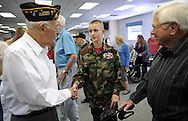 SOUTHAMPTON, PA -  NOVEMBER 11: Fred Blickle (L) and Herb Martin (R) greet young marine Cpl. Luke Sliwinski, 12, after he spoke to the veterans November 11, 2013 at Southampton Estates in Southampton, Pennsylvania. (Photo by William Thomas Cain/Cain Images)