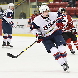 WELLINGTON, - Dec 11, 2015 -  Exhibition Game 2- Team USA vs Team Canada East at the 2015 World Junior A Challenge at the Wellington District Community Centre, ON. Mitch Reinke #8 of Team United States follows the play during the second period.<br /> (Photo: Andy Corneau / OJHL Images)