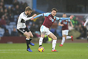 Fulham defender Joe Bryan (23) challenges 12 Robbie Brady for Burnley FC during the Premier League match between Burnley and Fulham at Turf Moor, Burnley, England on 12 January 2019.