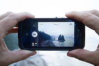 Taking an iphone photo of Rialto Beach in Olympic National Park, WA