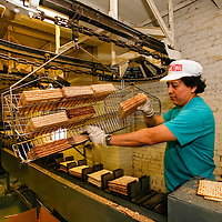 Streit's Matzoh, NYC. Cages carry stacks of matzoh from the oven to the packaging department where they will be packed in boxes.