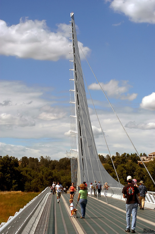 Architect Santiago Calatrava designed the Sundial Bridge in Redding. the $23 million footbridge It crosses the Sacramento River and never touches the water.  The working Sundial is 700 feet long, 23 feet wide and 217 feet high (pylon). The bridge weighs 3.2 million pounds (1,600 tons) and is composed of steel with galvanized steel cables. The deck materials are non-skid glass panels in steel framework with granite accents. The foundation consists of 115 tons of rebar, 1,900 cubic yards of concrete and a superstructure of 400 tons of steel. 200 tons of glass and granite were utilized in deck construction. The bridge contains 4,342 feet of cable and the pylon is 580 tons of steel.