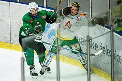 Nik Simsic of SZ Olimpija vs Maximilian Wilfan of Lustenau during Ice Hockey match between HK SZ Olimpija and EHC Alge Elastic Lustenau in Semifinal of Alps Hockey League 2018/19, on April 1, 2019, in Arena Tivoli, Ljubljana, Slovenia. Photo by Vid Ponikvar / Sportida
