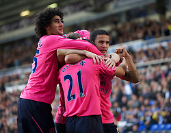BIRMINGHAM, ENGLAND - Saturday, October 2, 2010: Everton's Leon Osman celebrates the opening goal against Birmingham City with team-mates Marouane Fellaini and Tim Cahill during the Premiership match at St Andrews. (Photo by David Rawcliffe/Propaganda)