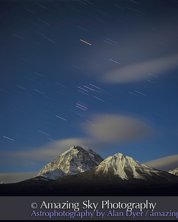 Orion setting in March over Mt Temple near Lake Louise in Banff National Park, Alberta. <br /> <br /> Taken in full moonlight with Plaubel Makina 6x7 camera, Fujichrome Velvia 50 slide film, 120-format, 80mm lens at f/5.6 and about 25 minute exposure. taken from Bow Valley viewpoint on Bow Valley Parkway.