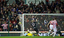 STOKE-ON-TRENT, ENGLAND - Boxing Day Wednesday, December 26, 2012: Liverpool's goalkeeper Jose Reina is beaten for the third time as Stoke City's Jonathan Walters scores the third goal, his second of the game, during the Premiership match at the Britannia Stadium. (Pic by David Rawcliffe/Propaganda)
