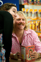 "Leigh Francis in character as TV JUICE host Keith Lemon poses for photos with fans while signing copies of his new book. 'Keith Lemon: The Rules""  when he stopped in at WHSmith Meadowhall shopping centre in Sheffield. The event scheduled for 5:00 - 5:30 was so popular that Keith started signing early and didn't finish until 7:05pm as well as sales of the book being restricted.  .1st November 2011. Image © Paul David Drabble"
