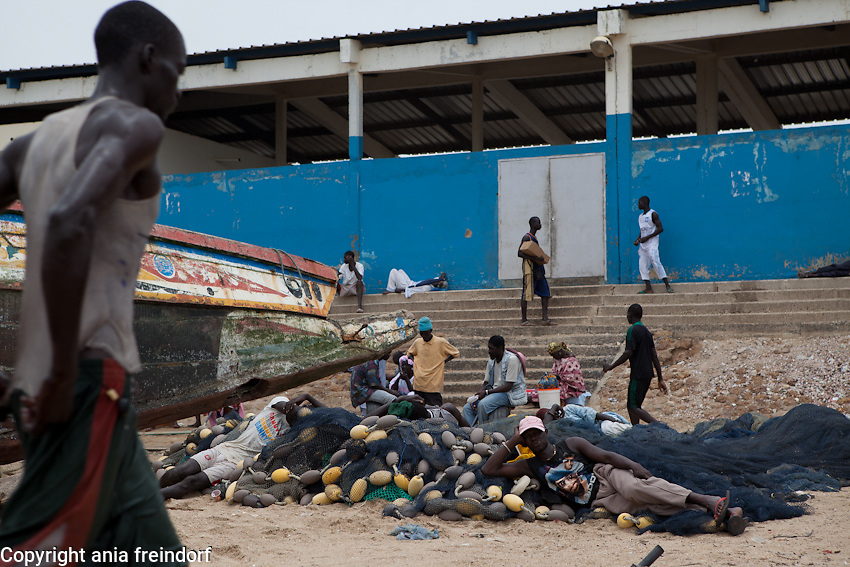 Africa, Senegal, Mbour, the second largest artisanal fishing port in West Africa, the environmental fishing crisis  is due to lack of management, poor sanitation and hygiene.Wastes which average 11.4 tons daily constitute a health hazard and environmental concern..A side effect of fish processing is environmental pollution and the population's lack of awareness.Taboos and food prohibitions in Joal have disastrous consequences on the nutritional state and health of the population including even the women fish processors..Senegal stopped renewing agreements allowing European and Chinese fishing vessels in its waters in 2006, but now an expanding artisanal fleet and local industrial boats practice exclusivity under Tax regulations are being blamed for malpractice and degrading the country's main economic and food resource. .This crisis is reported to be one of the main causes of hunger inside the country and clandestine emigration from Senegal's major fishing communities to Europe over the last two years with the death of hundreds of fishermen.The cancellation, in May 2012, of 29 fishing authorizations granted to foreign vessels by the new Senegalese government is beginning already to have beneficial effects.
