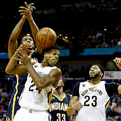 Dec 15, 2016; New Orleans, LA, USA; New Orleans Pelicans guard Buddy Hield (24) and Indiana Pacers forward Thaddeus Young (21) battle for a rebound with forward Anthony Davis (23) during the second half of a game at the Smoothie King Center. The Pelicans defeated the Pacers 102-95. Mandatory Credit: Derick E. Hingle-USA TODAY Sports