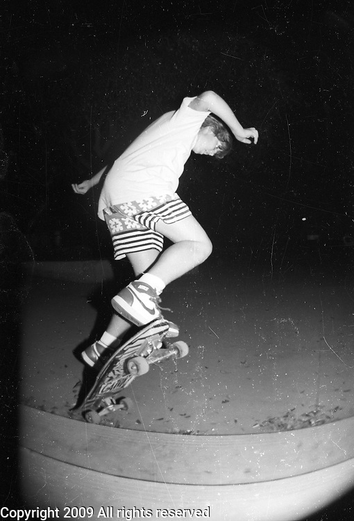 Brian Hulse ollies during a late night skateboarding session at Monache High School in Porterville, California.