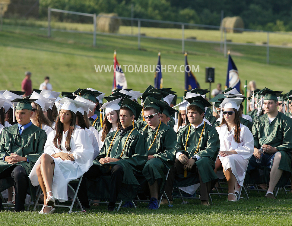 The Minisink Valley High School Class of 2013 listens to a speaker during graduation ceremonies on the football field on Friday, June 21, 2013.