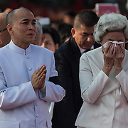 Cambodian Norodom Sihamoni and  former Queen Monineath Sihanouk walk in a procession as Royal Cambodian Guards and Buddhist monks move the body of former Cambodian King Norodom Sihanouk during funeral services Friday Feb. 1, 2013 in Phnom Penh, Cambodia.