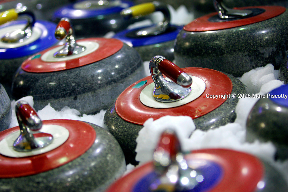 Curling stones sit on ice for a couple of hours to bring them down to the correct temperature for competition. Each stone is made of granite and weighs 42 pounds. Jody Berger tries her hand at curling with members of the Broadmoor Curling Club at the Chapel Hills Mall Ice Arena in Colorado Springs on Tuesday January 31, 2006. Curling dates back to the 16th century and is a strategic game like shuffleboard and bowling on ice with 42 pound granite stones.The Broadmoor Curling Club was established in 1968 and currently plays on Tuesday evenings from October through March at the Chapel Hills Mall Ice Arena..(MARC PISCOTTY/ © 2006)