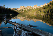 Idaho. Sawtooth National Recreation Area. Hell Roaring Lake. Mount Cramer and Finger of Fate reflecting in calm water.