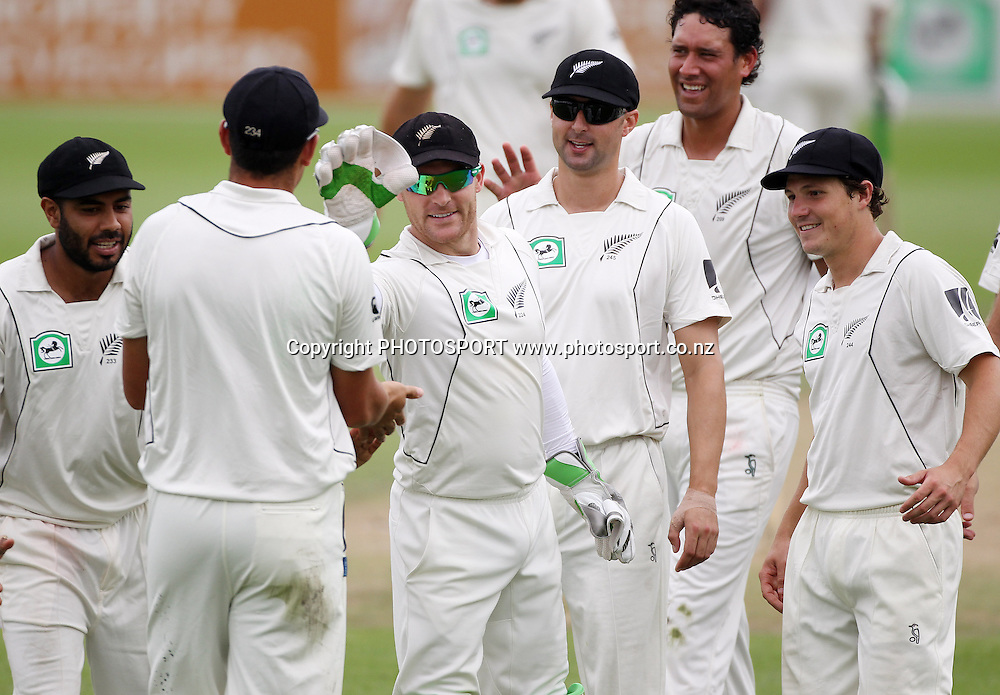 Players converge to congratulate Ross Taylor after taking a catch to dismiss Aftab Ahmed.<br />Day 3. Test match cricket. One off test.<br />New Zealand Black Caps versus Bangladesh.<br />Seddon Park, Hamilton, New Zealand.<br />Tuesday 17 February 2010.<br />Photo: Andrew Cornaga/PHOTOSPORT