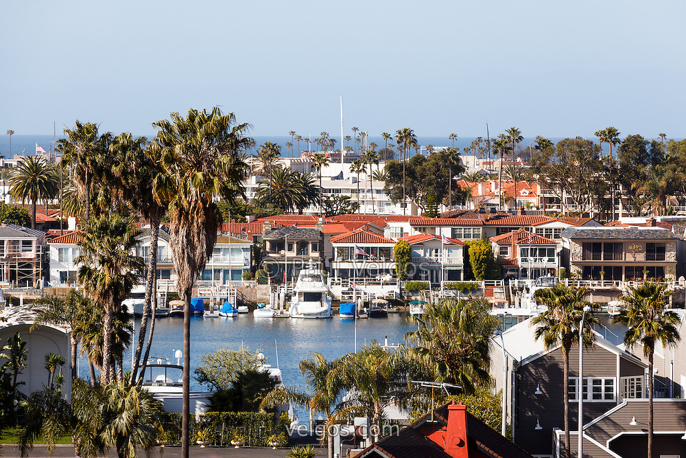Photo of Newport Beach California waterfront luxury homes in Orange County. Photo is high resolution and was taken in 2012.