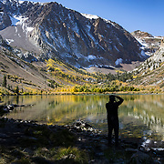 A photographer at Parker Lake taking photos of the colors.