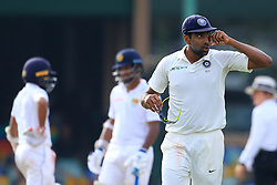 August 4, 2017 - Colombo, Sri Lanka - Indian cricketer Ravichandran Ashwin (R) walks off after completing an over during the 2nd Day's play in the 2nd Test match between Sri Lanka and India at the SSC international cricket stadium at the capital city of Colombo, Sri Lanka on Friday 04 August 2017. (Credit Image: © Tharaka Basnayaka/NurPhoto via ZUMA Press)
