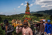 Javanese worshippers bring Gunungan contains of vegetables and fruits during a ritual of sacrificial to mark the establisment of their village on the hills near ancient city of Yogyakarta, Indonesia, June 14, 2012. In Javanese philosophy, there are two worlds that human should deal with; macrocosm and microcosm. Macrocosm deals with spirituality and mystery, whereas microcosm deals with reality and physic. The aim of life is to harmonize the both. Javanism is a way of living, merely like Hinduism or Buddhism. It is a thought that stresses on inner peace, balance and harmony and it contains complete tools to interpret life whether it is the Sein (Being) or the Werden (Becoming).