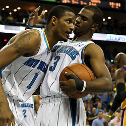 April 24, 2011; New Orleans, LA, USA; New Orleans Hornets point guard Chris Paul (3) and small forward Trevor Ariza (1) against the Los Angeles Lakers during the fourth quarter in game four of the first round of the 2011 NBA playoffs at the New Orleans Arena. The Hornets defeated the Lakers 93-88.   Mandatory Credit: Derick E. Hingle