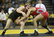 January 22 2010: Iowa's Grant Gambrall works on Ohio State's C.J. Magrum during the 184-pound bout an NCAA wrestling dual at Carver-Hawkeye Arena in Iowa City, Iowa on January 22, 2010. Grambrall defeated Magrum 10-3 and Iowa defeated Ohio State 33-3..