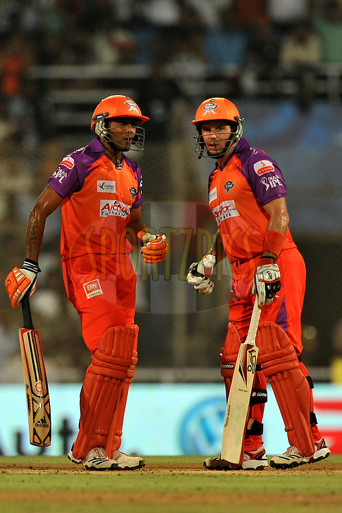 Ravindra Jadeja of Kochi Tuskers Kerala and Brad Hodge of Kochi Tuskers Kerala during  match 10 of the Indian Premier League ( IPL ) Season 4 between the Pune Warriors and the Kochi Tuskers Kerala held at the Dr DY Patil Sports Academy, Mumbai India on the 12th April 2011..Photo by Pal Pillai /BCCI/SPORTZPICS