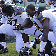 ORLANDO, FL - JANUARY 01:  Missouri football players pray prior to the start of the Buffalo Wild Wings Citrus Bowl between the Minnesota Golden Gophers and the Missouri Tigers at the Florida Citrus Bowl on January 1, 2015 in Orlando, Florida. (Photo by Alex Menendez/Getty Images) *** Local Caption ***