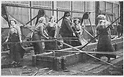 World War I - 1914-1918.  After conscription in 1916, women took over many civilian jobs.  British women manual labourers on a shipyard.