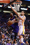 Feb 10, 2016; Phoenix, AZ, USA; Phoenix Suns guard Archie Goodwin (20) drives to the basket against Golden State Warriors center Andrew Bogut (12) at Talking Stick Resort Arena. The Golden State Warriors won 112-104. Mandatory Credit: Jennifer Stewart-USA TODAY Sports