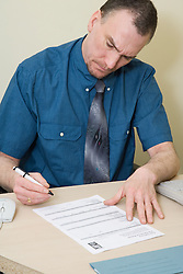 Probation Officer filling in a PreSentence Report,