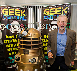"**FILE PICTURE - Monday December 21 marks 100 days since Jeremy Corbyn became leader of the Labour Party** © Licensed to London News Pictures. 26/09/2015. Brighton, UK. Leader of the Labour Party JEREMY CORBYN poses next to a darlek underneath the words ""GEEK CENTRAL"" during a visit to Entrepreneurial Spark in Brighton, a group that promotes entrepreneuring. The visit takes place on the eve of the Labour Party conference, which is being held in Brighton Photo credit: Ben Cawthra/LNP"