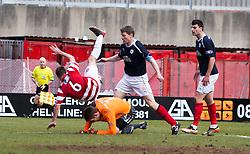 Hamilton's Jon Routledgen goes over Falkirk's keeper Michael McGovern..Hamilton 1 v 2 Falkirk, Scottish Cup quarter-final, Saturday, 2nd March 2013..©Michael Schofield.